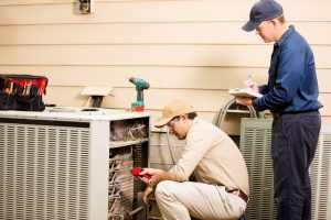 technicians-assess-air-conditioner