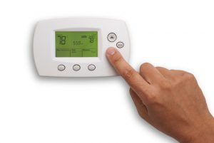 digital-thermostat-hand-78