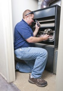 man-servicing-furnace-tech