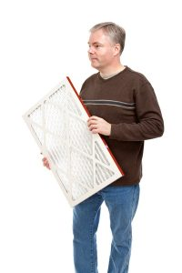 man holding air filter
