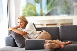 woman sitting comfortably in home
