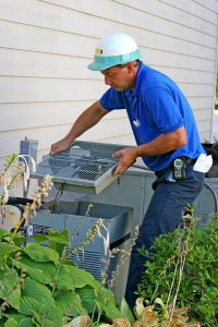 AC technician working on air conditioner