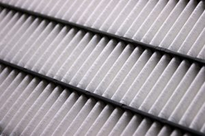 Close-up of the elements of a clean car air filter; dynamic shot using diagonal lines.